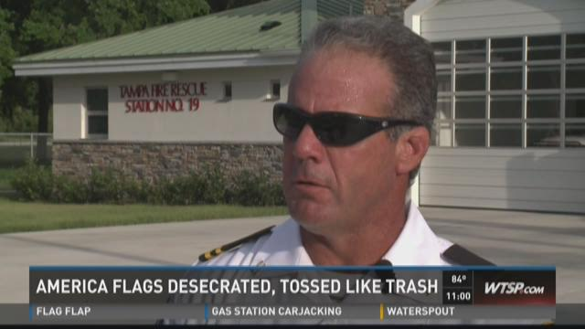 Firefighters find flags in dumpster