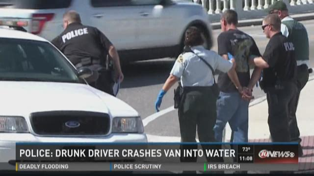Man charged with DUI after crashing van into water