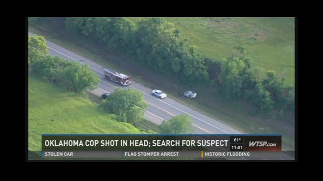 Oklahoma cop shot in head; search for suspect
