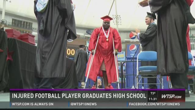 Injured Northeast High player walks for graduation
