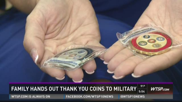 Family gives thank you coins to military members