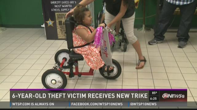 6-year-old theft victim receives new trike