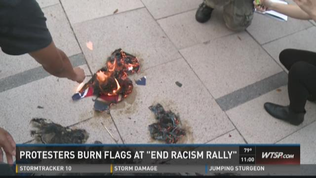 "Protesters burn flags at ""End Racism Rally"""