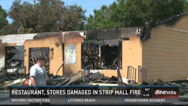 Restaurant, stores, damaged in strip mall fire