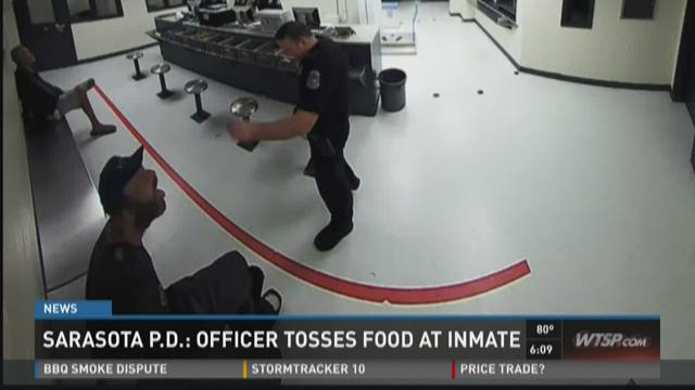 Video shows officer tossing food into inmate's mouth
