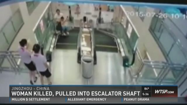 Woman killed, pulled into escalator shaft