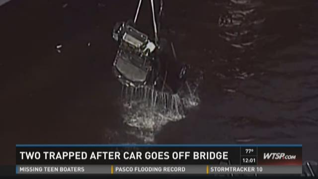 Two trapped after car goes off bridge