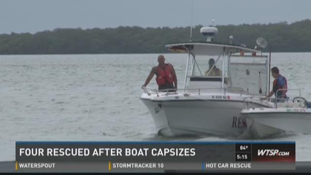 Four rescued after boat capsizes