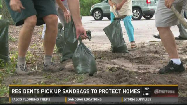 Residents pick up sandbags to protect homes