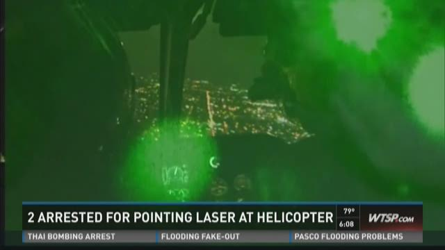 2 arrested for pointing laser at helicopter