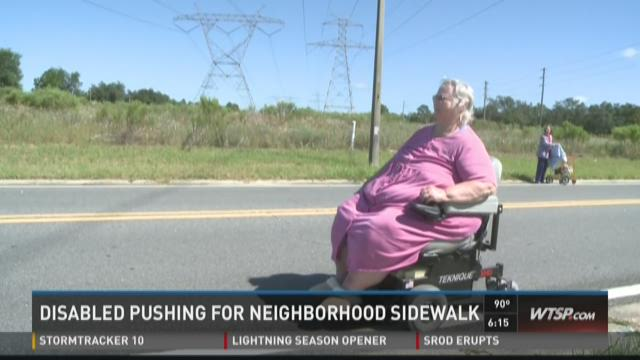 Disabled pushing for neighborhood sidewalk